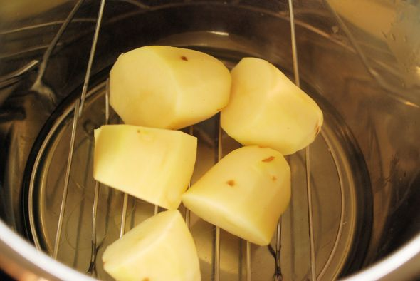 Raw potatoes in pot